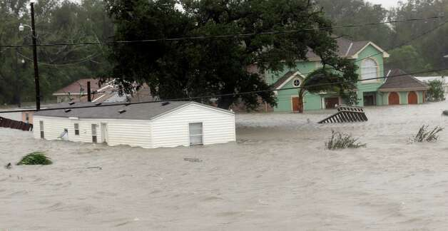 Homes are flooded as Hurricane Isaac hits Wednesday, Aug. 29, 2012, in Braithwaite, La. As Isaac made landfall, it was expected to dump as much as 20 inches of rain in several parts of Louisiana. (AP Photo/David J. Phillip) Photo: David J. Phillip, Associated Press / AP