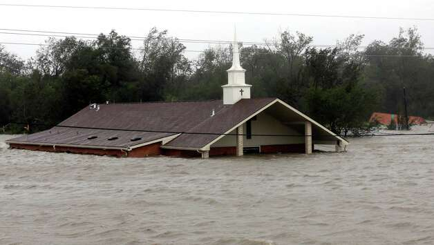 A church is flooded as Hurricane Isaac hits Wednesday, Aug. 29, 2012, in Braithwaite, La. (AP Photo/David J. Phillip) Photo: David J. Phillip, Associated Press / AP