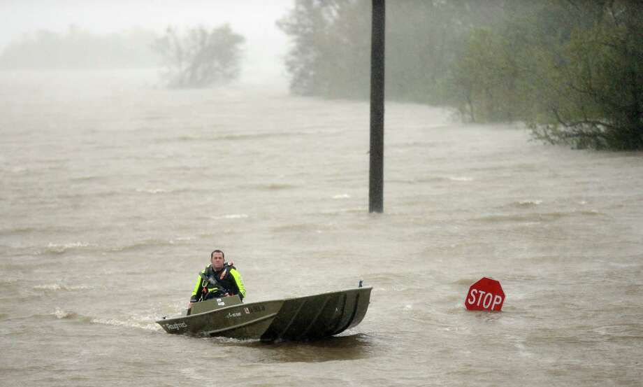BRAITHWAITE, LA - AUGUST 29: A rescue boat passes a partially submerged stop sign during Hurricane Isaac on August 29, 2012 in Braithwaite, Louisiana. Dozens were reportedly rescued in the area after levees in Plaquemines Parish were overtopped by floodwaters from Hurricane Isaac. Photo: Mario Tama, Getty Images / 2012 Getty Images