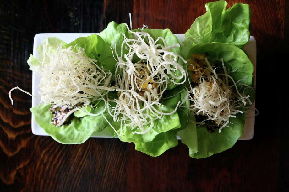 Peking-style duck lettuce wraps from Cypress Grille in Boerne. Photo: Helen L. Montoya, San Antonio Express-News / ©SAN ANTONIO EXPRESS-NEWS