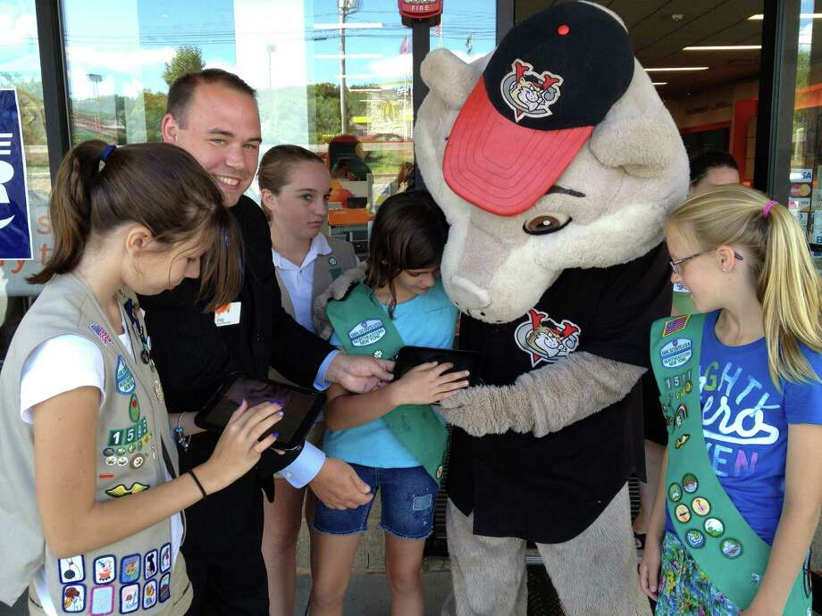 "Junior Girl Scouts from Troop 1511, (Wynantskill) take the pledge online, using AT&T tablets, not to text and drive with AT&T officials and the Valley Cat mascot.  Pictured (L-R) is Girl Scout Emily Kaarstad, AT&T's Gregory Melita, Girls Scouts Sarah Meemken and Kia Plumadore, ""Southpaw"", the Valley Cats mascot and Girl Scout Eleanor Cepiel. The scouts also received a special patch, ""It Can Wait"" for their commitment not to text and drive and to do their utmost to encourage other scouts and adults to take the pledge at www.itcanwait.com AT&T recently kicked off a new ""It Can Wait"" program to educate the public on the dangers of texting and driving and is calling on all Americans on September 19 to go online and take the pledge not to text and drive from that day forward. The goal is to make texting and driving as unacceptable as drinking and driving."