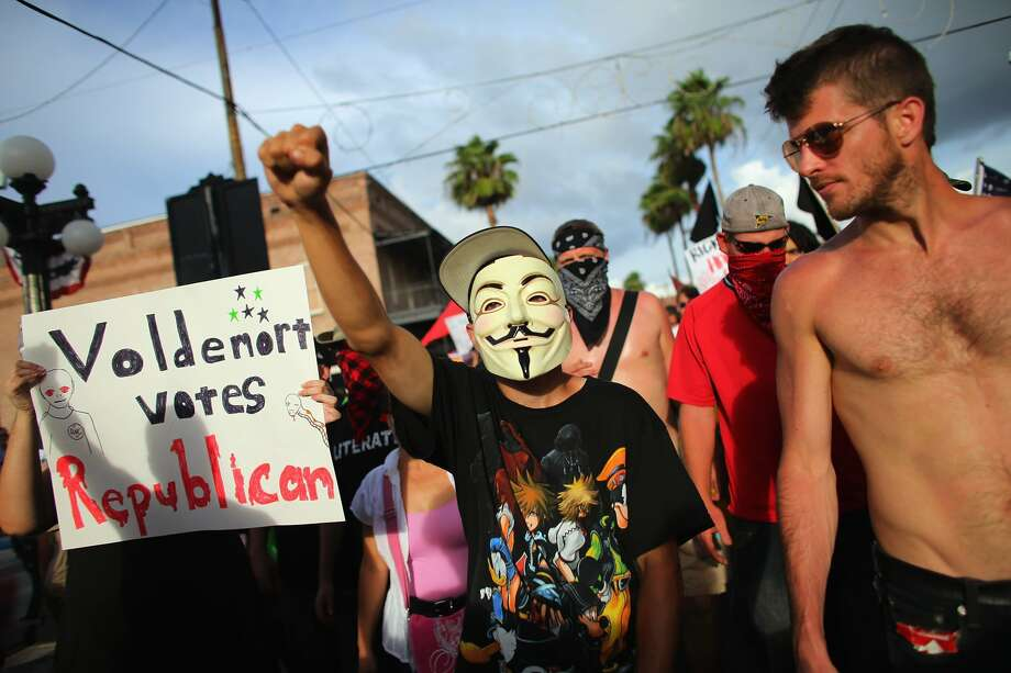 TAMPA, FL - AUGUST 28:  Protesters walk together through the streets on the first full day of the Republican National Convention at the Tampa Bay Times Forum on August 28, 2012 in Tampa, Florida. The Republican party delegates were prepared to affirm Mitt Romney as the party's nominee as the convention began its first full session after the start was delayed due to Hurricane Isaac.  (Joe Raedle/Getty Images) (Joe Raedle / Getty Images)