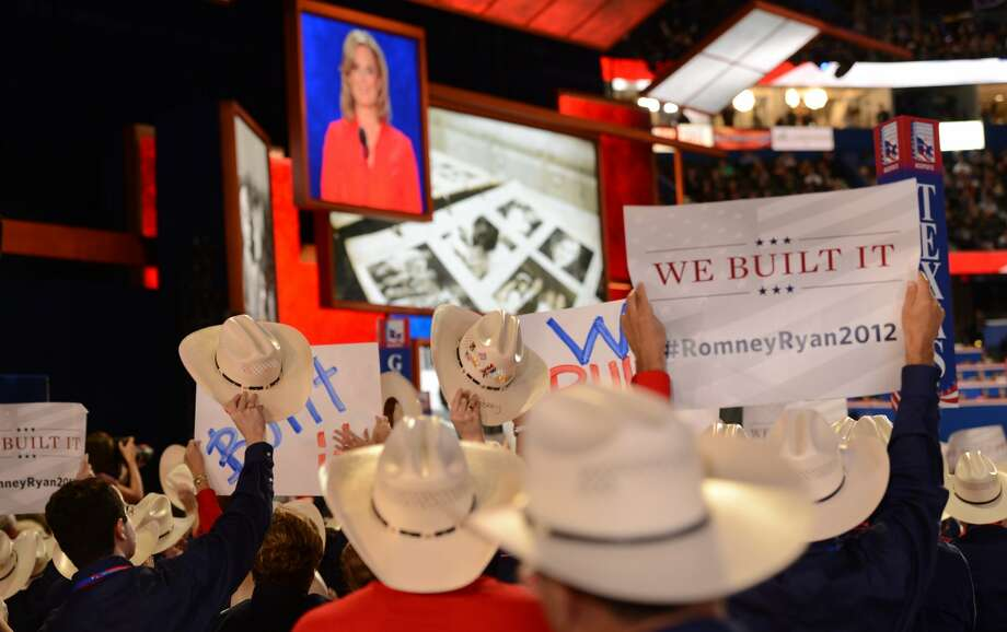 Supporters waive signs as Ann Romney speaks about husband and Republican presidential candidate Mitt Romney and her family at the Tampa Bay Times Forum in Tampa, Florida, on August 28, 2012 during the Republican National Convention. (Robyn BECKROBYN BECK/AFP/GettyImages) (ROBYN BECK / AFP/Getty Images)