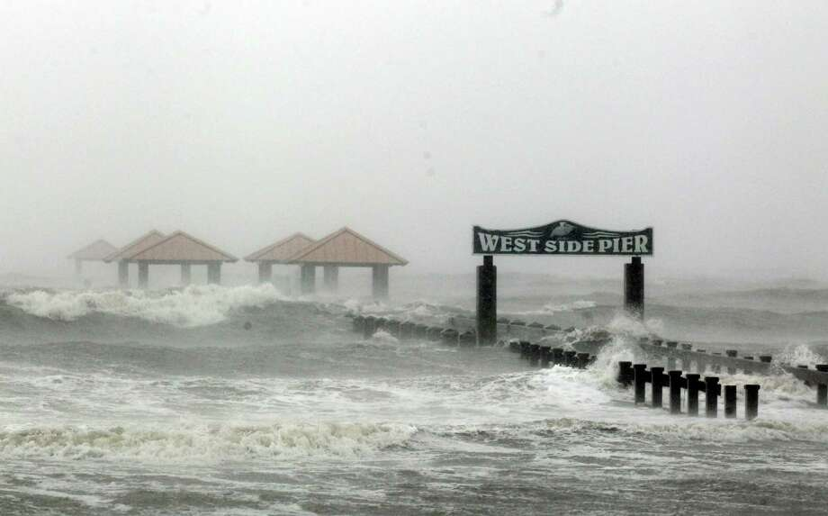 Waves from Hurricane Isaac batter the a pier, Wednesday, Aug. 29, 2012, in Gulfport, Miss. Isaac pelted parts of south Mississippi with heavy rains, flooding some homes in low-lying areas and turning parts of beachside U.S. Highway 90 into a river near Biloxi casinos. (AP Photo/John Bazemore) Photo: John Bazemore, Associated Press / AP