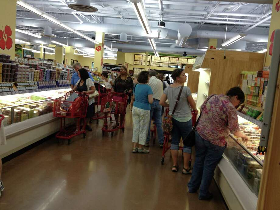 The Trader JoeÕs in Fort Worth is the first of nine stores the privately held, Monrovia, Calif.-based specialty grocer has announced it will open in Texas through 2014. (Richard Marini/San Antonio Express-News)