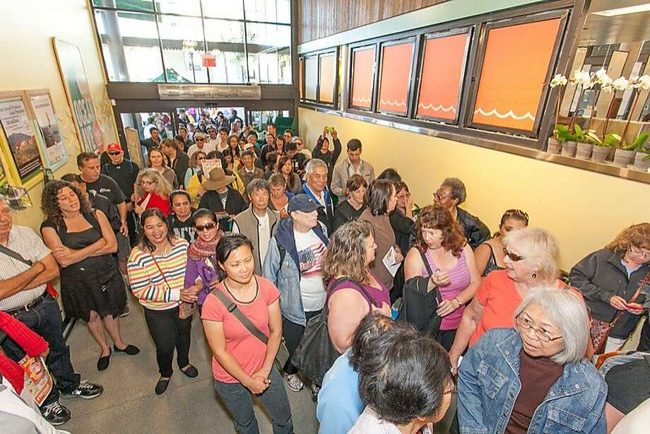 Crowds come through the door at the new Whole Foods store in the Ingleside district of S.F. Photo: Whole Foods, Whole Foods
