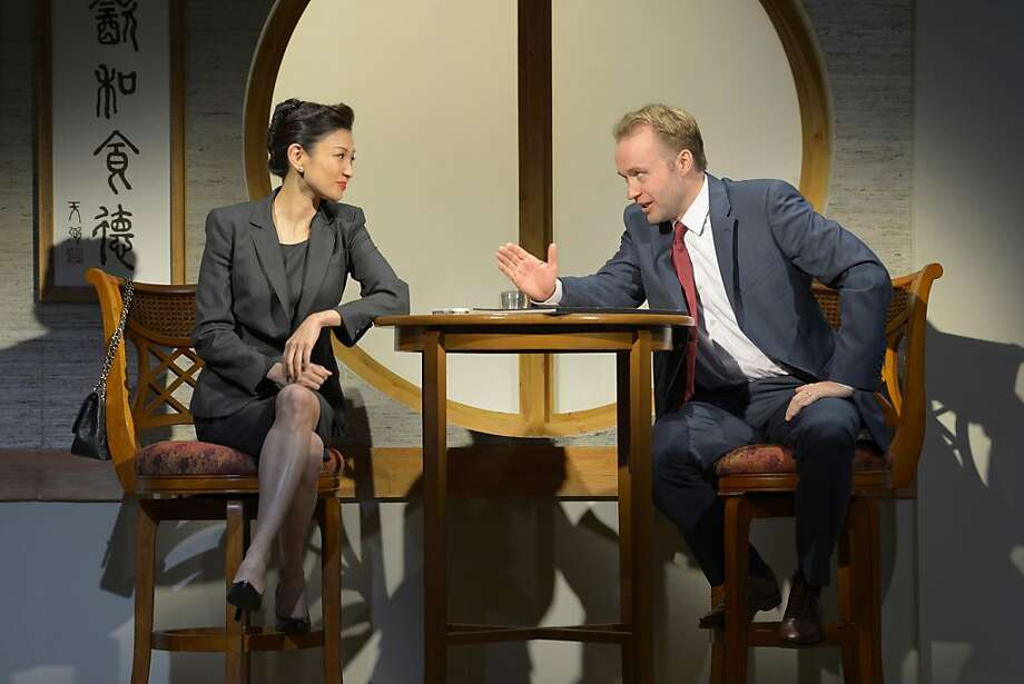 "Xi Yuan (Michelle Krusiec), as deputy minister, meets privately with American businessman Daniel Cavanaugh (Alex Moggridge) to discuss his project in David Henry Hwang's ""Chinglish"" at Berkeley Repertroy Theatre Photo: Kevinberne.com"