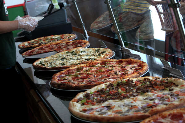 A wide variety of pizzas are available by the slice at Yaghi's New York Pizzeria in San Antonio on Wednesday, August 29, 2012.