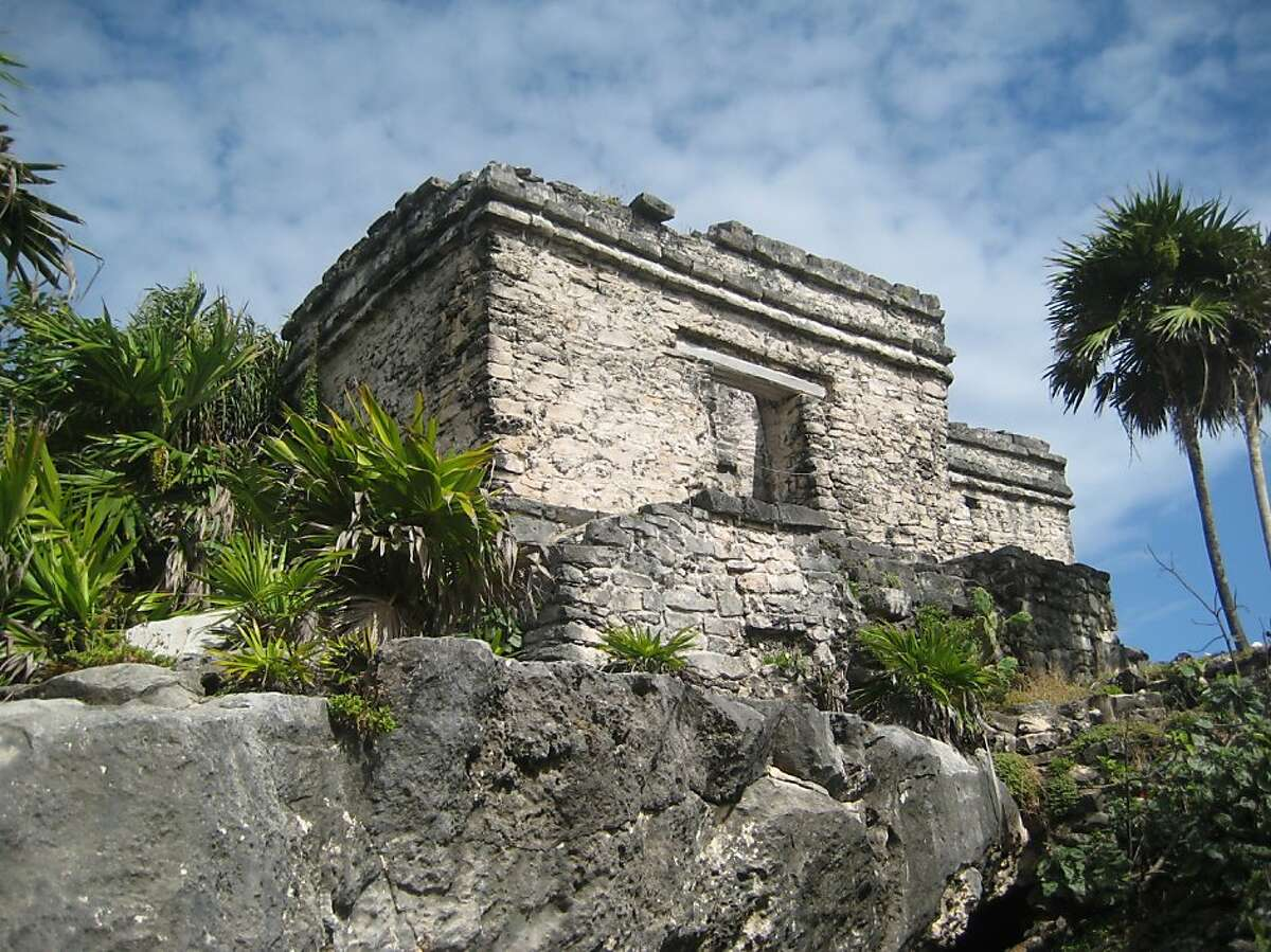 This December 2011 photo shows a pyramid at the Mayan ruins in Tulum, Mexico. Early morning visitors to the ancient archaeological sites on Mexico's Riviera Maya can avoid the crowds that often gather later in the day. (AP Photo/Kim Curtis)