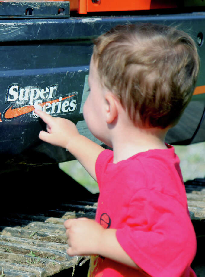 Jack Leonard, 2, of Warren carefully participates in the Touch-a-Truck benefit recently in Kent.  Courtesy of James Chip Leonard Photo: Contributed Photo