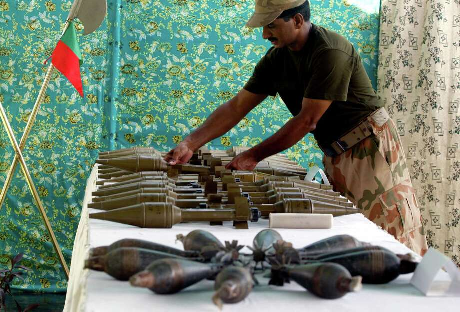 Weapons reportedly recovered from hideouts of militants in tribal areas are displayed in Peshawar, Pakistan on Wednesday. Photo: Mohammad Sajjad / AP