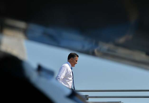 US Republican presidential candidate Mitt Romney boards his campaign plane in Indianapolis, Indiana, on August 29, 2012. Romney lies neck-and-neck with Obama in national polls 10 weeks before an election that should be his for the taking, given the sour economy and an unemployment rate that is lingering stubbornly above eight percent. AFP PHOTO/Jewel SamadJEWEL SAMAD/AFP/GettyImages Photo: Jewel Samad, AFP/Getty Images