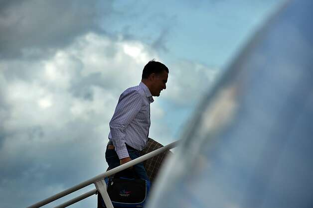 US Republican presidential candidate Mitt Romney boards his campaign plane at Tampa International Airport in Tampa, Florida, on August 29, 2012 en route to Indianapolis, Indiana. Romney lies neck-and-neck with Obama in national polls 10 weeks before an election that should be his for the taking, given the sour economy and an unemployment rate that is lingering stubbornly above eight percent. AFP PHOTO/Jewel SamadJEWEL SAMAD/AFP/GettyImages Photo: Jewel Samad, AFP/Getty Images