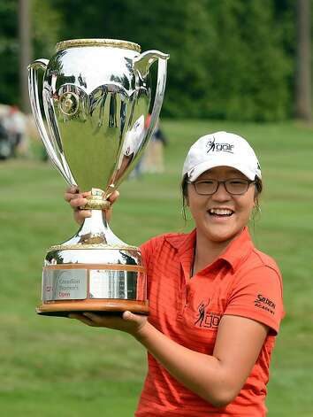 Lydia Ko, the highest-ranked female amateur at age 15, won the Canadian Women's Open to become the youngest player to win an LPGA Tour event. Photo: Harry How, Getty Images