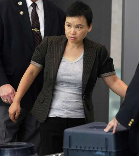 Hanjuan Jin, enters the federal courthouse Wednesday, Aug. 29, 2012, in Chicago, before being sentenced to four years in prison for stealing trade secrets from Motorola. Jin, who worked as a software engineer for Motorola Inc. for nine years, was stopped during a random security search at Chicago's O'Hare International Airport on Feb. 28, 2007, before she could board a flight to China. Prosecutors say she was carrying $31,000 and hundreds of confidential Motorola documents, many stored on a laptop, four external hard drives, thumb drives and other devices.(AP Photo/M. Spencer Green) Photo: M. Spencer Green / AP