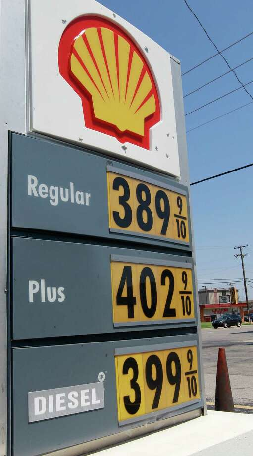 A Shell gas station advertises regular gas prices at 3.899 in Oklahoma City, Wednesday, Aug. 29, 2012. Gas prices in Oklahoma are up about 7-and-a-half cents per gallon from last week and up almost 27 cents from a month ago. (AP Photo/Sue Ogrocki) Photo: Sue Ogrocki