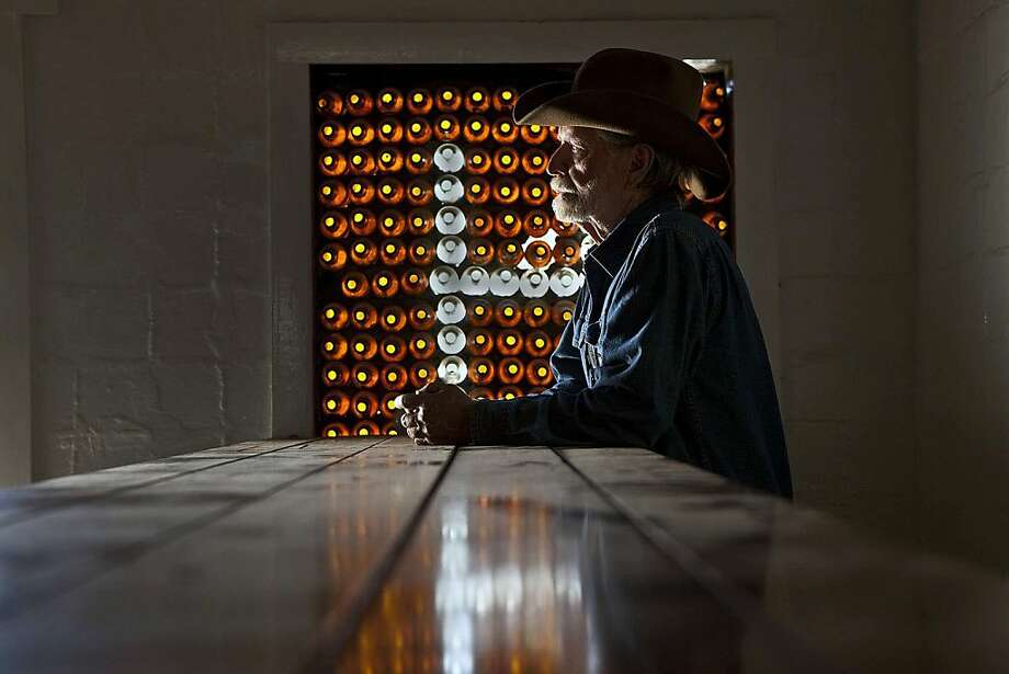 Tom Wolf sits at his bar, the Pine Mountain Inn, which he's owned since 1976. Wolf claims the county rezoned his land without telling him and wants to run him out of business. Photo: Arkasha Stevenson, McClatchy-Tribune News Service