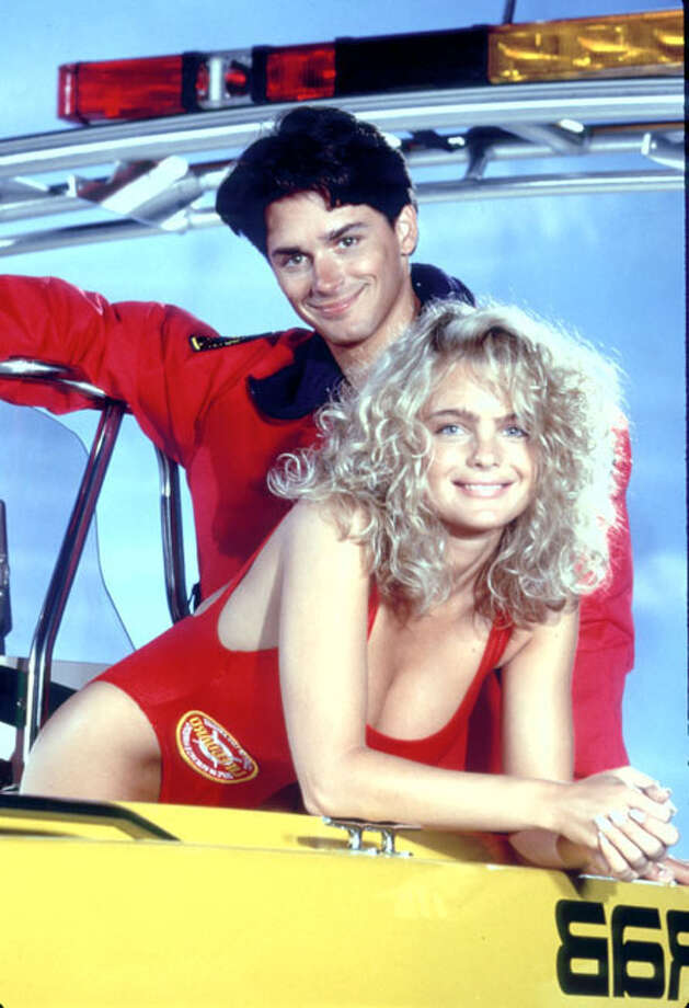 Erika Eleniak, who also appeared in Playboy, and Billy Warlock, were part of the original cast of Baywatch when it debuted on NBC in 1989. (Baywatch originally was canceled after one season and then saved in syndication). Photo: Unknown / Unknown