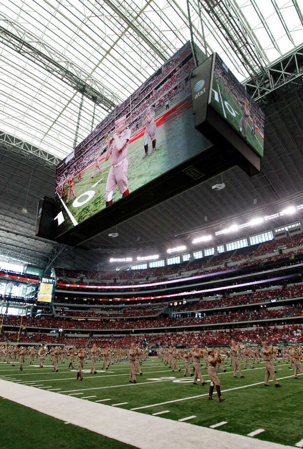 The Aggie Band will get well-acquainted with Cowboys Stadium since Texas A&M and Arkansas have agreed to play one another there from 2014-24. Photo: KIN MAN HUI, SAN ANTONIO EXPRESS-NEWS / San Antonio Express-News