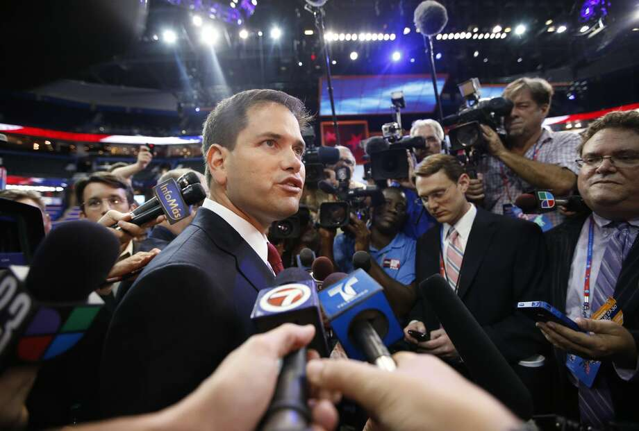 Sen. Marco Rubio, R-Fla., is surrounded by reporters during a tour of the convention floor at the Republican National Convention in Tampa, Fla., on Wednesday, Aug. 29, 2012. (Jae C. Hong/AP) (Jae C. Hong / Associated Press)