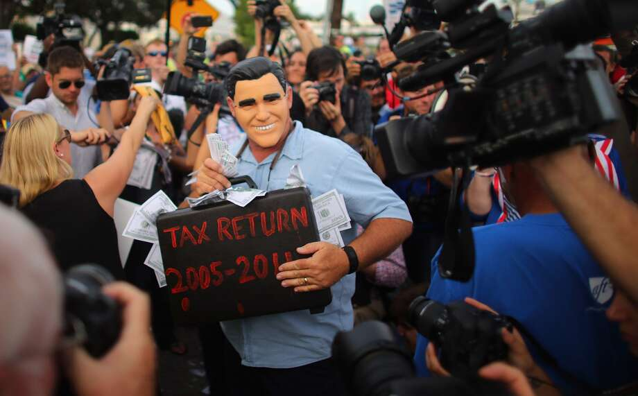 "TAMPA, FL - AUGUST 29: A protester wearing a Mitt Romney mask participates in a march that was put on by West Central Florida Federation of Labor to, in their words, ""demonstrate the reality of Mitt Romney's America"" as the Republican National Convention continues at the Tampa Bay Times Forum on August 29, 2012 in Tampa, Florida. The Republican party delegates affirmed Mitt Romney as the party's nominee for President of the United States.  (Joe Raedle/Getty Images) (Joe Raedle / Getty Images)"