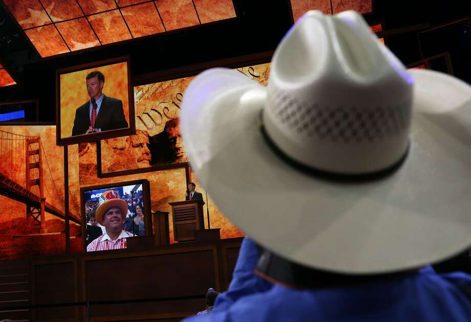 TAMPA, FL - AUGUST 29:  A man in a cowboy hat watches as U.S. Sen. Rand Paul (R-KY) speaks during the third day of the Republican National Convention at the Tampa Bay Times Forum on August 29, 2012 in Tampa, Florida.  Former Massachusetts Gov. Mitt Romney was nominated as the Republican presidential candidate during the RNC, which is scheduled to conclude August 30.  (Spencer Platt/Getty Images) (Spencer Platt / Getty Images)