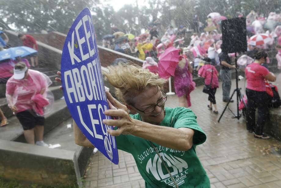 Catherine Akin, of Jasper, Fla., a demonstrators participate in a protest rally in the rain, Wednesday, Aug. 29, 2012, in Tampa, Fla. Protestors gathered in Tampa to march in demonstration against the Republican National Convention. (Patrick Semansky/AP) (Patrick Semansky / Associated Press)