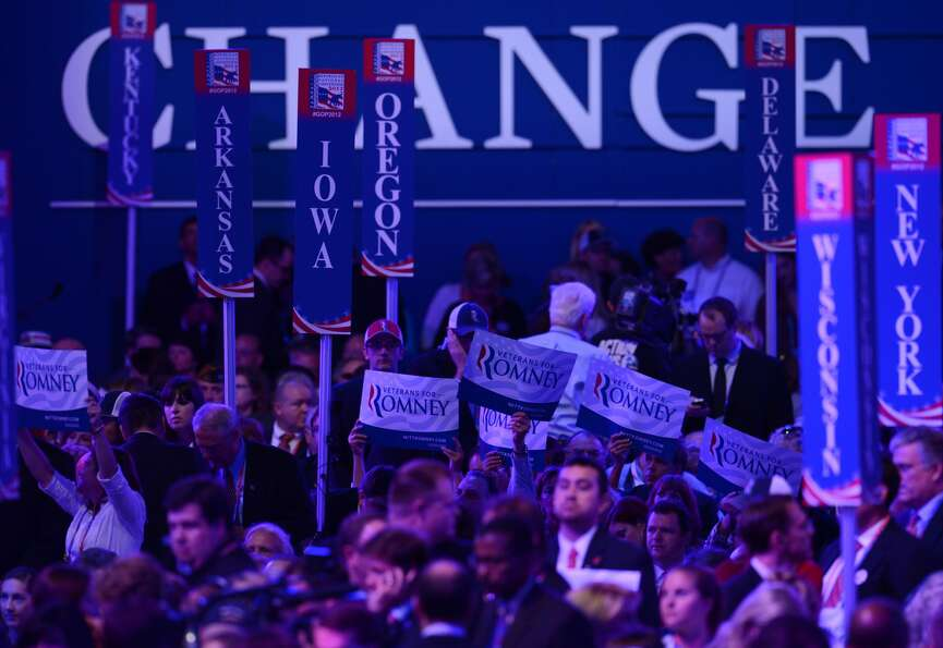 Delegates display support signs at the Tampa Bay Times Forum in Tampa, Florida, on August 29, 2012 d