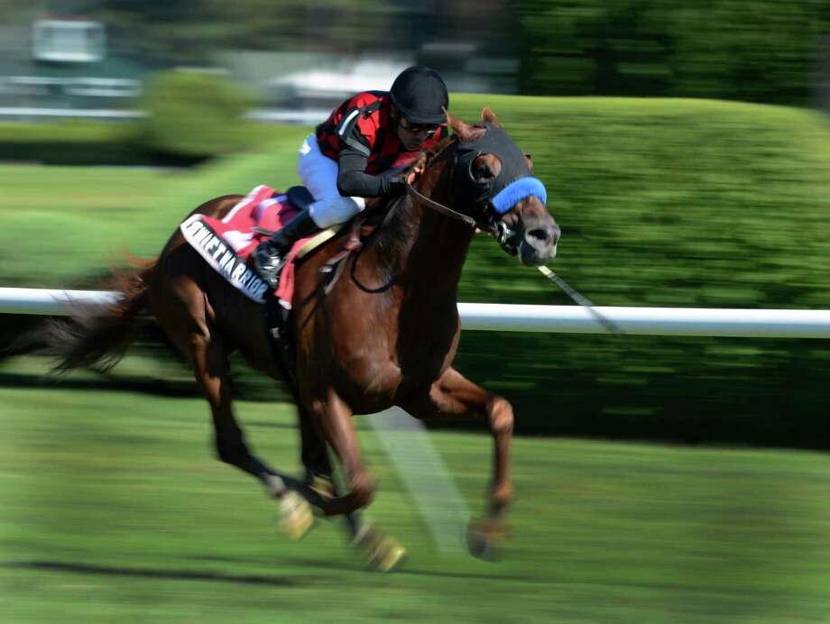 Swift Warrior with jockey Jose Espinoza is shown in motion on the way to victory in the first running of The Win at the Saratoga Race Course in Saratoga Springs, N.Y. Aug. 29, 2012.     (Skip Dickstein/Times Union) Photo: Skip Dickstein