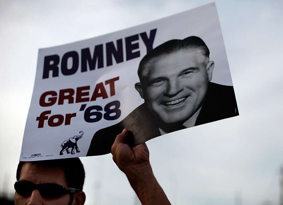 TAMPA, FL - AUGUST 29:  A protester holds up a sign during a march that was put on by West Central Florida Federation of Labor to, in their words, 'demonstrate the reality of Mitt Romney's America' as the Republican National Convention continues at the Tampa Bay Times Forum on August 29, 2012 in Tampa, Florida. The Republican Party delegates affirmed Mitt Romney as the party's nominee for President of the United States. Photo: Tom Pennington, Getty Images