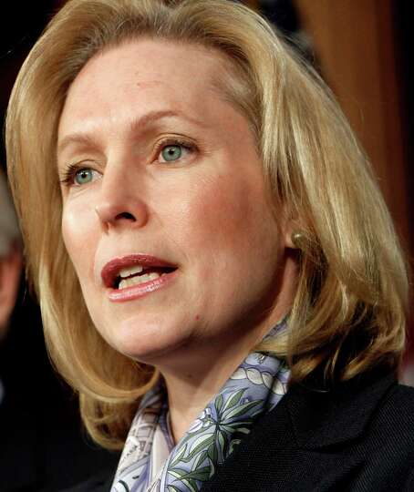 Sen. Kirsten Gillibrand, D-N.Y., right, accompanied by Sen. Joe Lieberman, I-Conn. speaks during a n