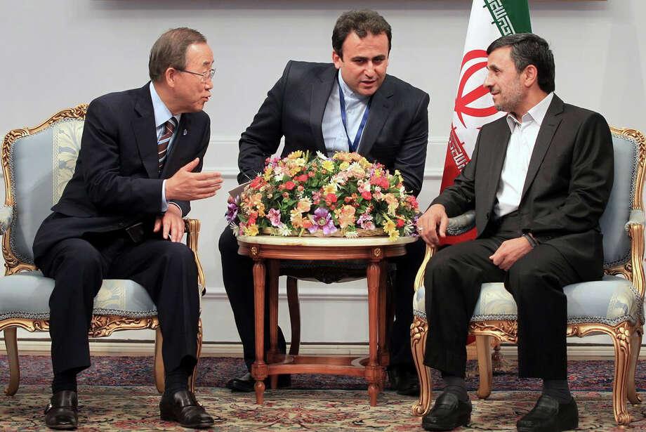 U.N. Secretary-General Ban Ki-Moon, left, on Wednesday pressed concerns about human rights in Iran with President Mahmoud Ahmadinejad, right. Photo: Mohsen Rafinejad / Iranian Presidency Office