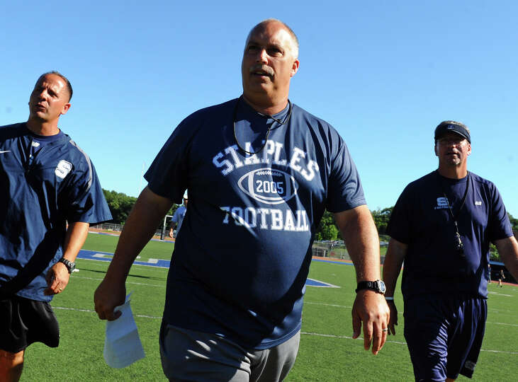 Staples High School football Head Coach Marce Petroccio during scrimage action against Bunnell High