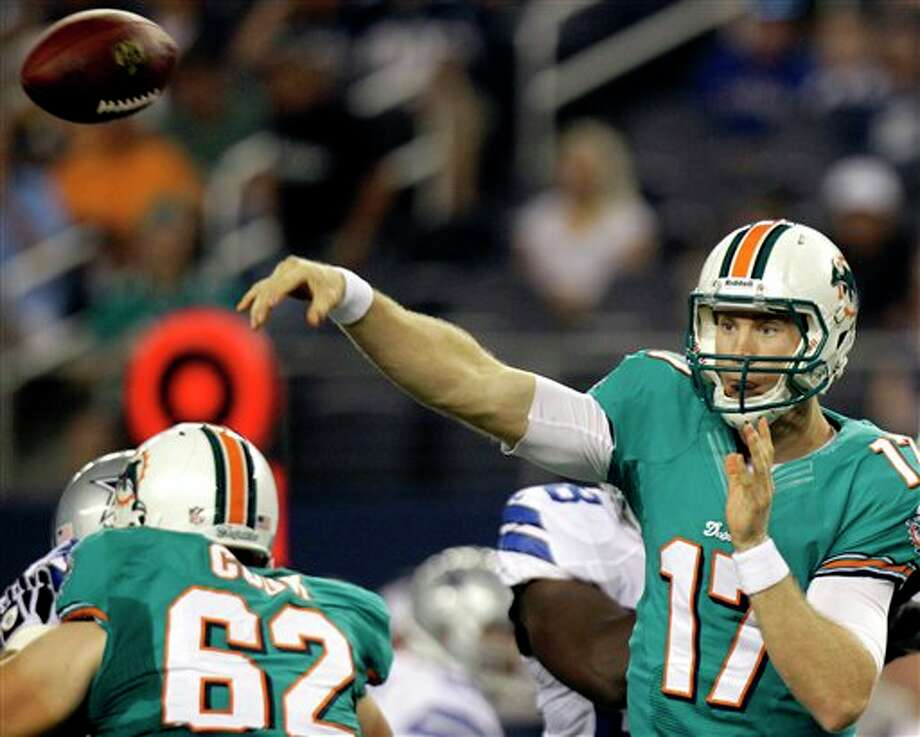 Miami Dolphins quarterback Ryan Tannehill (17) passes against the Dallas Cowboys during the first half of a preseason NFL football game, Wednesday, Aug. 29, 2012, in Arlington, Texas. (AP Photo/LM Otero) Photo: LM Otero, Associated Press / AP