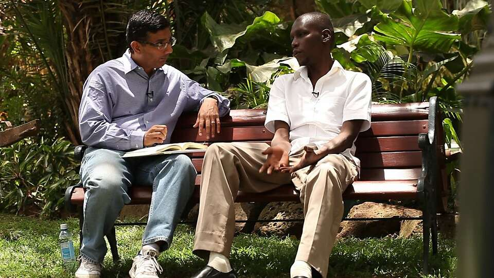 Dinesh D'Souza (left) with the president's half-brother George Obama in