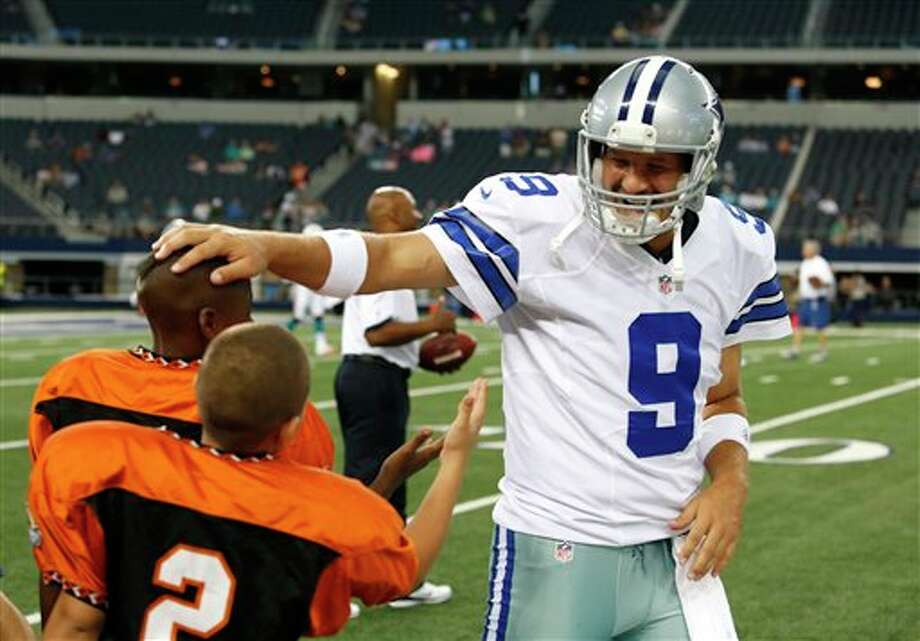Dallas Cowboys' Tony Romo (9) kids with young football players before a preseason NFL football game against the Miami DolphinsWednesday, Aug. 29, 2012, in Arlington, Texas. (AP Photo/Sharon Ellman) Photo: Sharon Ellman, Associated Press / FR170032 AP
