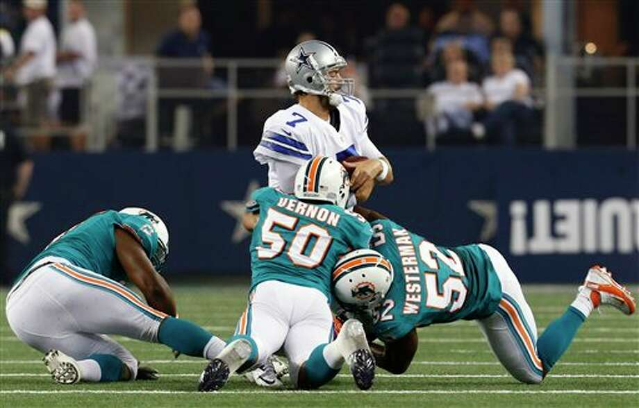 Miami Dolphins defensive tackle Kheeston Randall (97), defensive end Olivier Vernon (50), and linebacker Jamaal Westerman (52) take down Dallas Cowboys quarterback Stephen McGee (7) during the first half of a preseason NFL football game, Wednesday, Aug. 29, 2012, in Arlington, Texas. (AP Photo/Sharon Ellman) Photo: Sharon Ellman, Associated Press / FR170032 AP