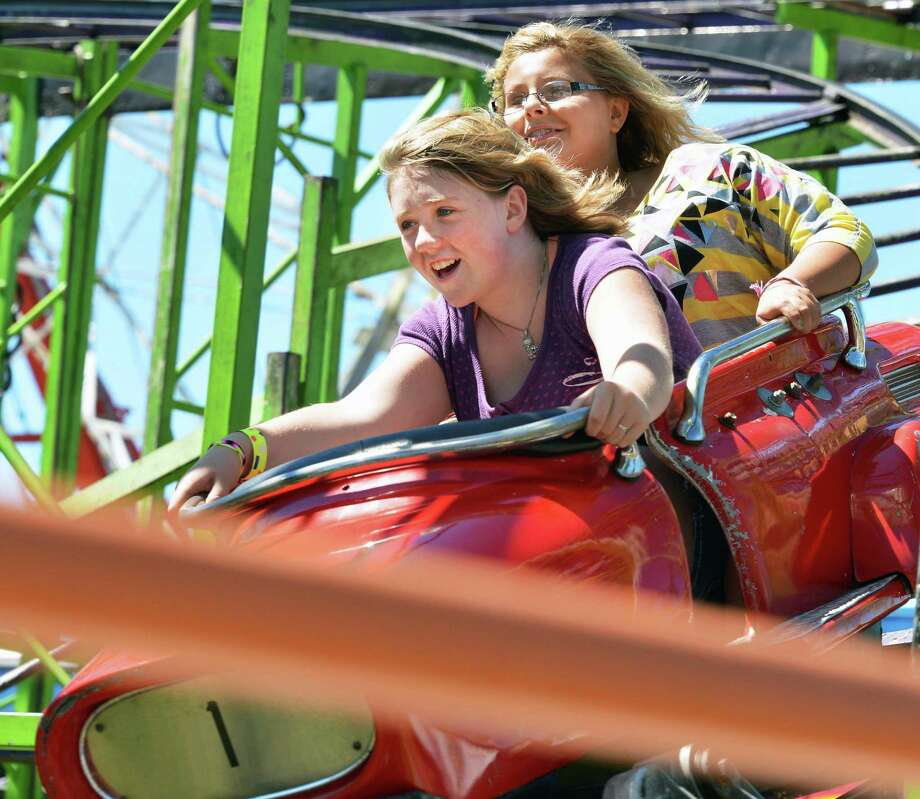 "Fallon Kennedy,12, left, and Caitlin Meyers, 11, both from Hague, on the ""Indy 500"" ride at the Schaghticoke Fair Wednesday Aug. 29, 2012.   (John Carl D'Annibale / Times Union) Photo: John Carl D'Annibale / 00018955A"