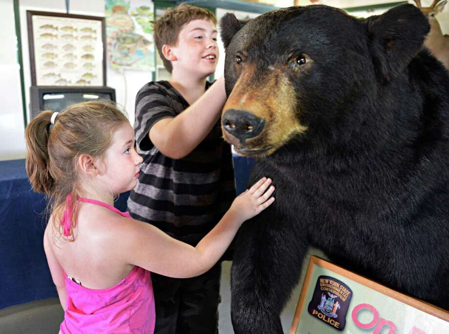 Six-year-old Kailyn Landgeon ,left, of Schuylerville and Haden Turnbull, 12, of Glens Falls check out a stuffed black bear at the Rensselaer Co. Conservation Alliance exhibit at the Schaghticoke Fair Wednesday Aug. 29, 2012.   (John Carl D'Annibale / Times Union) Photo: John Carl D'Annibale / 00018955A