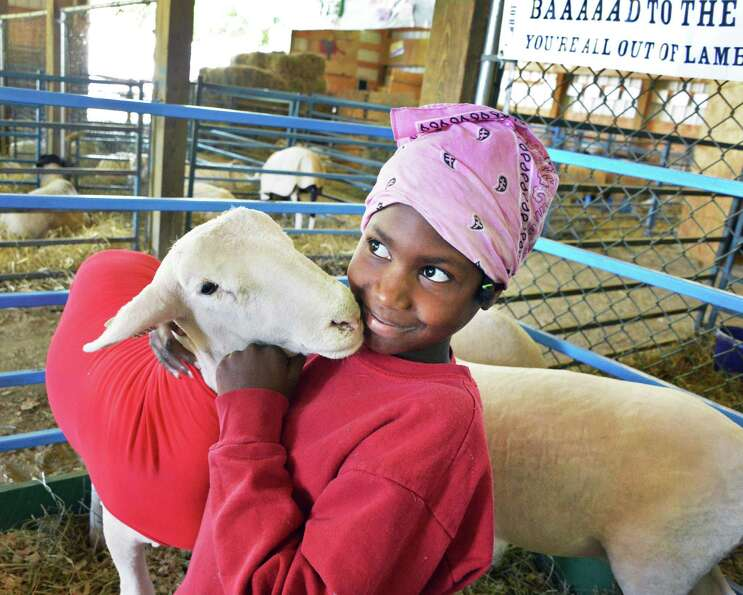 Emma Charest, 9, of Meadowpond Farm in Brunswick with her Dorset lamb on opening day of the Schaghti