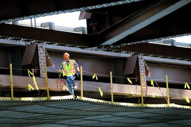 A worker walks along the scaffolding where the decks on the Thaddeus Kosciusko bridges will be replaced on Wednesday, Aug. 29, 2012, in Halfmoon, N.Y. The Twin Bridges, as it's known locally, carries I-87 traffic over the Mohawk River. (Cindy Schultz / Times Union) Photo: Cindy Schultz / 00019049A