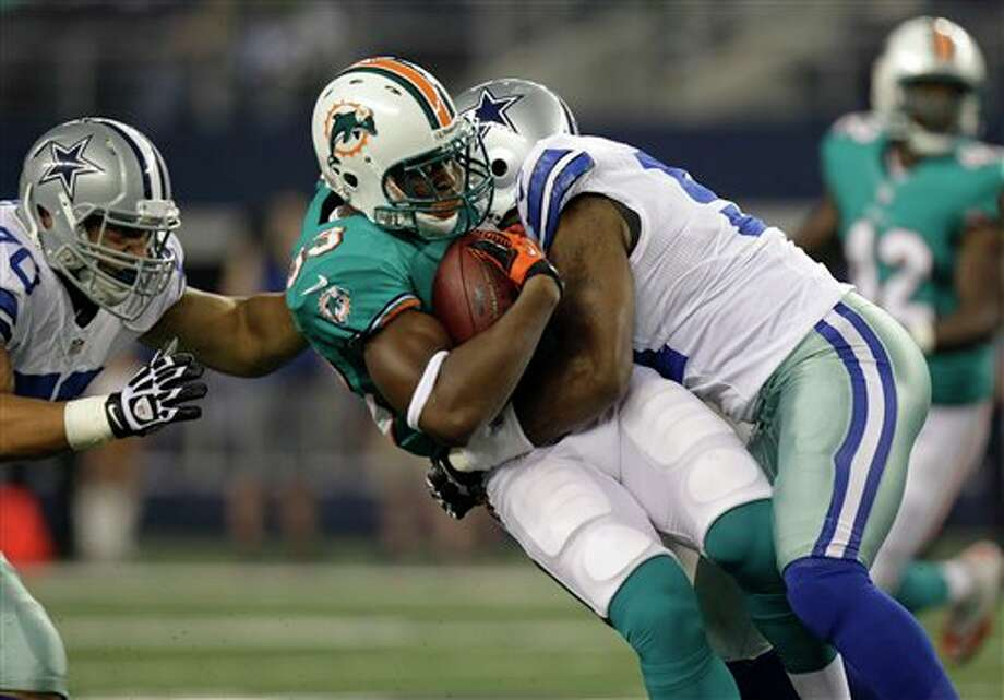 Miami Dolphins running back Daniel Thomas (33) is taken down on a short run during the first half of a preseason NFL football game against the Dallas Cowboys Wednesday, Aug. 29, 2012, in Arlington, Texas. (AP Photo/LM Otero) Photo: LM Otero, Associated Press / AP