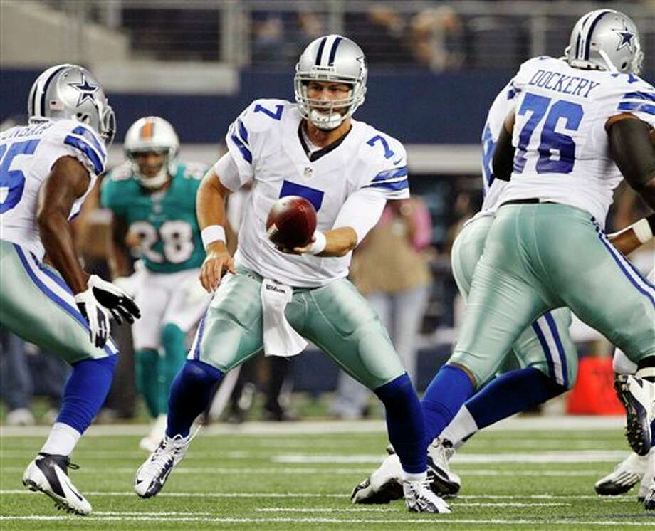 Dallas Cowboys quarterback Stephen McGee (7) hands the ball to Lance Dunbar (25) during the first half of a preseason NFL football game against the Miami Dolphins, Wednesday, Aug. 29, 2012, in Arlington, Texas. (AP Photo/Tony Gutierrez) Photo: Tony Gutierrez, Associated Press / AP