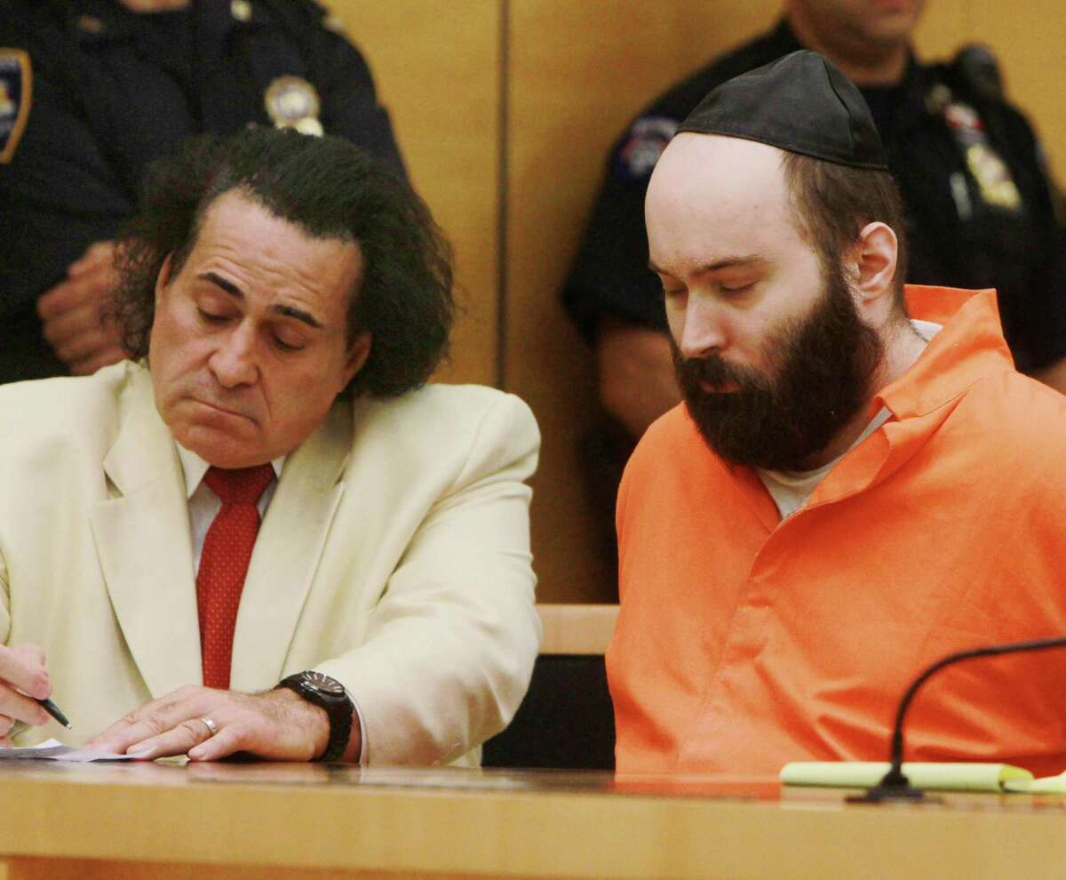 Levi Aron, center, appears in court for sentencing at State Supreme Court in the Brooklyn borough of New York, Wednesday, Aug. 29, 2012. Aron received 40 years to life in prison for the 2011 abduction and murder of eight year old Leiby Kletzky, who stopped to ask Aron for directions as he walked home from religious day camp. At left is defense Attorney Howard Greenberg. (AP Photo/New York Daily News, Jesse Ward, Pool)