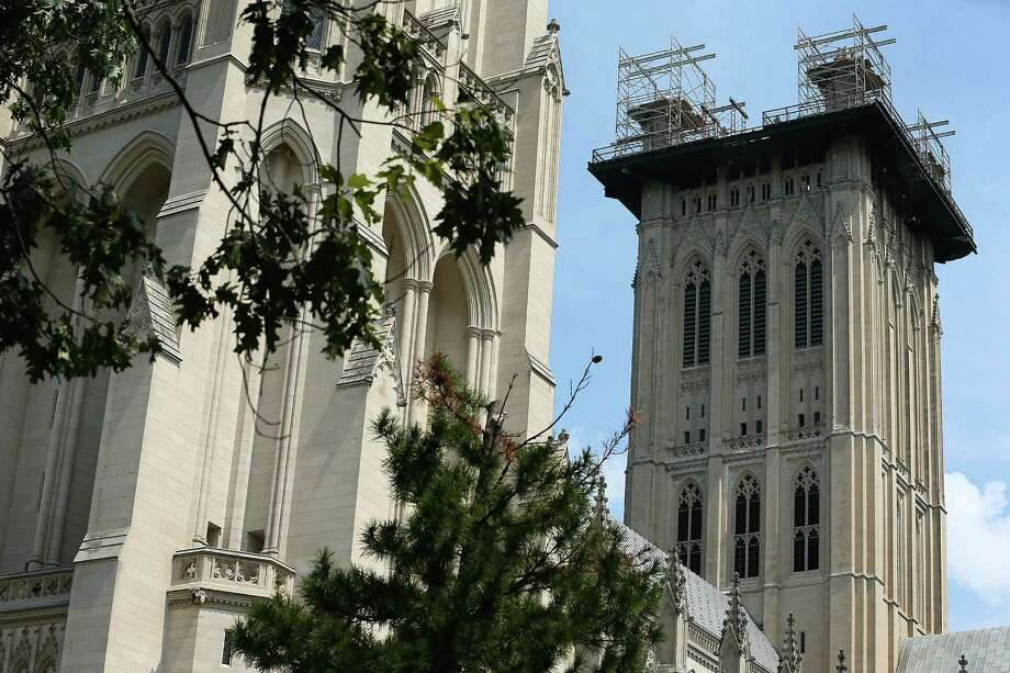 WASHINGTON, DC - AUGUST 23: Restoration on the grand pinnacles of the central tower of the Washington National Cathedral is undergoing as the cathedral marks the one year anniversary of the 5.8-magnitude earthquake that struck the area August 23, 2012 at the Washington National Cathedral in Washington, DC. A news conference and press tour was held to show the media what the latest development is on the restoration. The Lilly Endowment has donated $5 million to help repairing the damages by the quake. Photo: Alex Wong, Getty Images / 2012 Getty Images