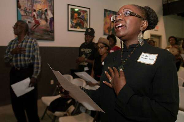 Rev. Nina Bryant-Sanyika sings during the New Orleans Association of Houston's observance of the seventh anniversary of Katrina at S.H.A.P.E Community Center on Wednesday, Aug. 29, 2012, in Houston.  Rev. Bryant-Sanyika was one of thousands that lost their home in Katrina.