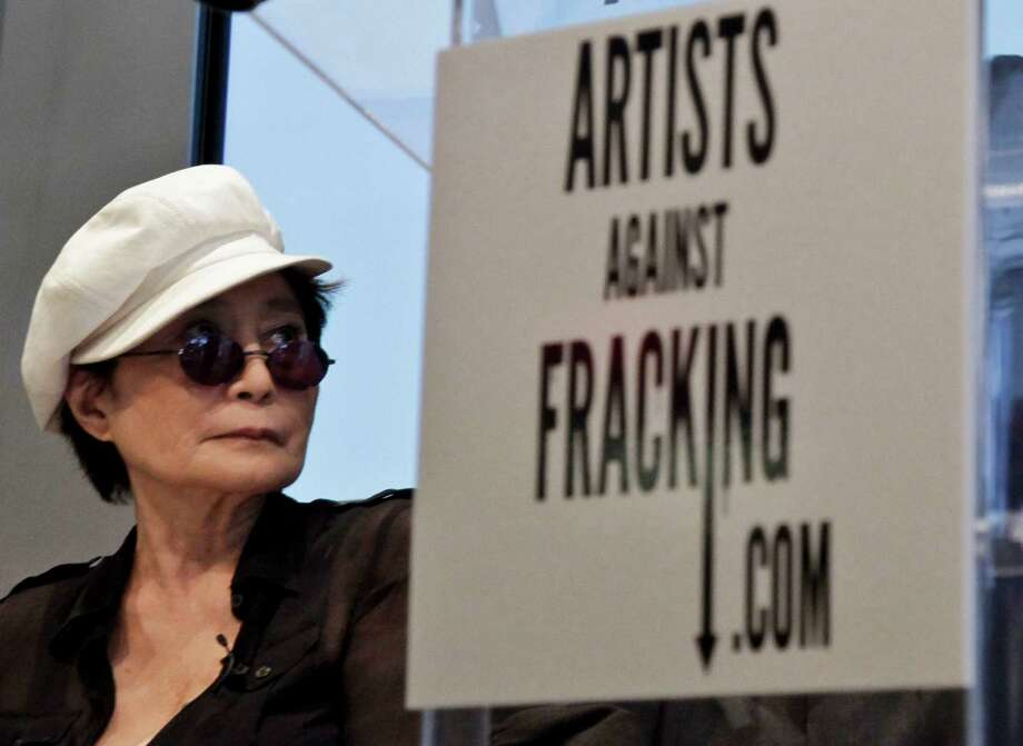 "Yoko Ono appears at a news conference to launch the coalition of artists opposing hydraulic fracturing on Wednesday, Aug. 29, 2012 in New York.  The formation of the group, called Artists Against Fracking, comes as New York Gov. Andrew Cuomo decides whether to allow shale gas drilling using high-volume hydraulic fracturing called hydrofracking. The group says such drilling is harmful and poses the threat of contamination. They say they want to spread awareness of the issue through ""peaceful democratic action.""  Cuomo is expected to allow drilling to begin on a limited basis near the Pennsylvania border.  The group is comprised of 146 members including Lady Gaga, Paul McCartney and Alec Baldwin.  (AP Photo/Bebeto Matthews) Photo: Bebeto Matthews"