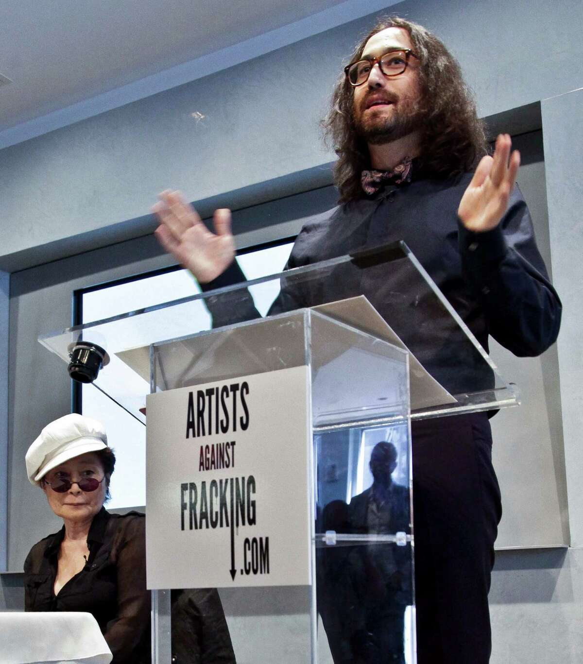 """Yoko Ono, left, listens as her son Sean Lennon speaks during a news conference to launch a coalition of artists opposing hydraulic fracturing on Wednesday, Aug. 29, 2012 in New York. The formation of the group, called Artists Against Fracking, comes as New York Gov. Andrew Cuomo decides whether to allow shale gas drilling using high-volume hydraulic fracturing called hydrofracking. The group says such drilling is harmful and poses the threat of contamination. They say they want to spread awareness of the issue through """"peaceful democratic action."""" Cuomo is expected to allow drilling to begin on a limited basis near the Pennsylvania border. The group is comprised of 146 members including Lady Gaga, Paul McCartney and Alec Baldwin. (AP Photo/Bebeto Matthews)"""