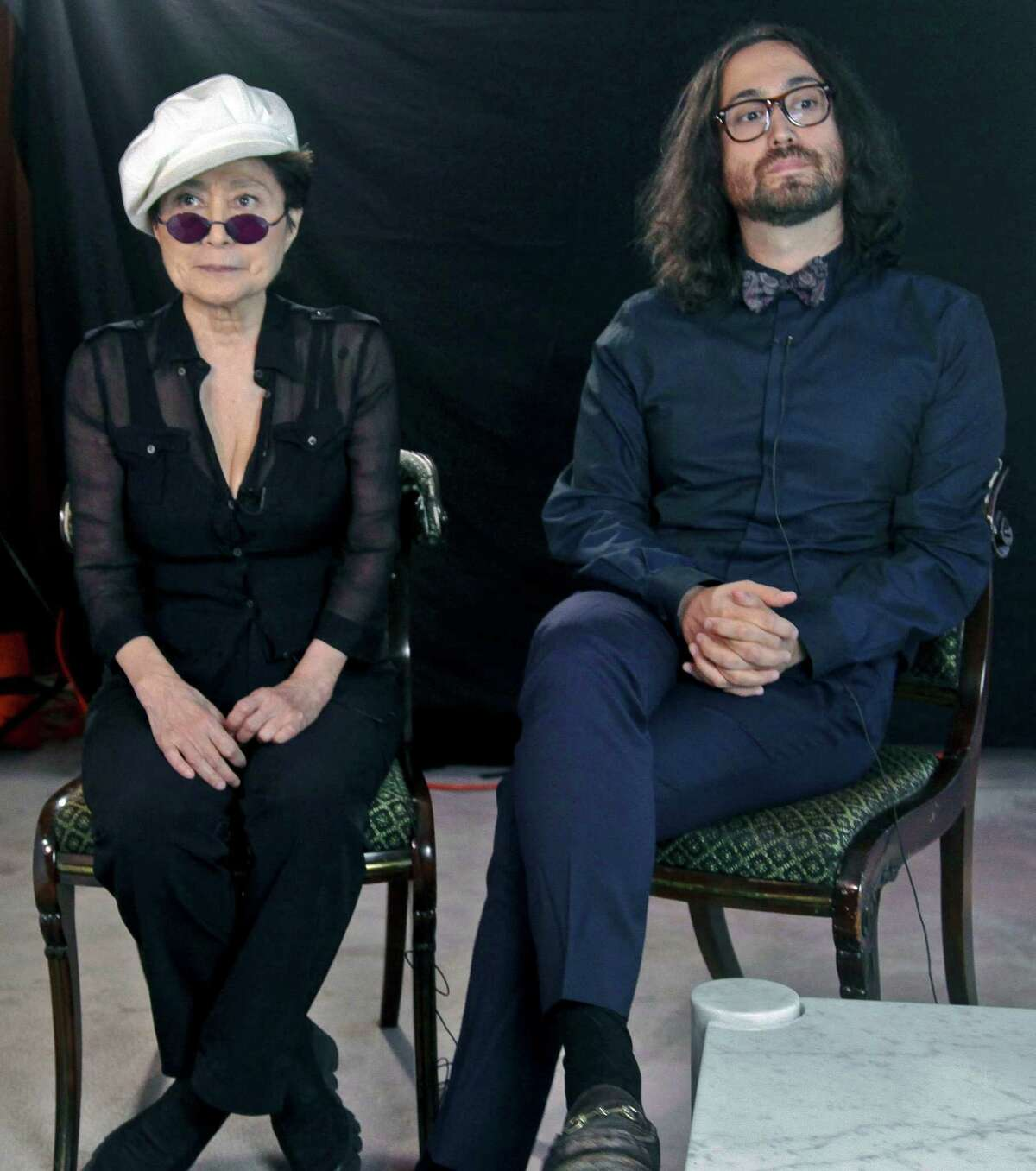 Yoko Ono, left, and her son Sean Lennon, right, listen during an interview, following the launch of a coalition of artists opposing hydraulic fracturing on Wednesday, Aug. 29, 2012 in New York. Lennon and Ono have joined the coalition called Artist Against Fracking to lobby Gov. Andrew Cuomo to ban the practice of drilling for gas in New York. (AP Photo/Bebeto Matthews)