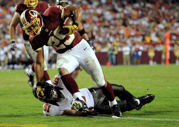 After sitting out the last two games with a sore Achilles, Redskins running back Roy Helu Jr. rushed for 90 yards and two TDs Wednesday. He could end up being Washington's starter. Photo: Nick Wass, Associated Press / FR67404 AP